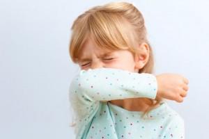 girl-sneezing-into-elbow